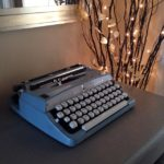 Simple home decor with vintage typewriter and twinkly white lights