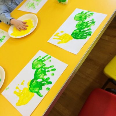 Messy fun creating handprint caterpillars at Toddler Group this morning