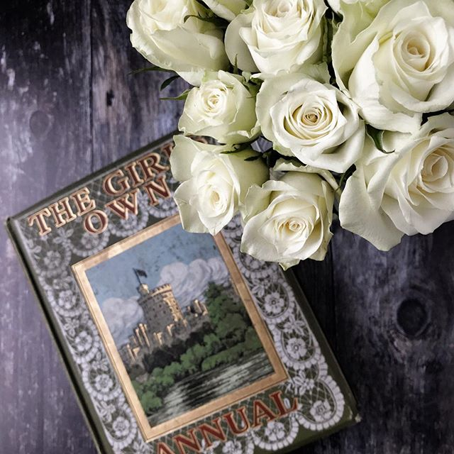 White roses and a vintage book